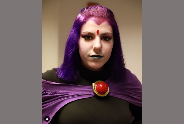Cosplay character dressed as Raven from Teen Titans