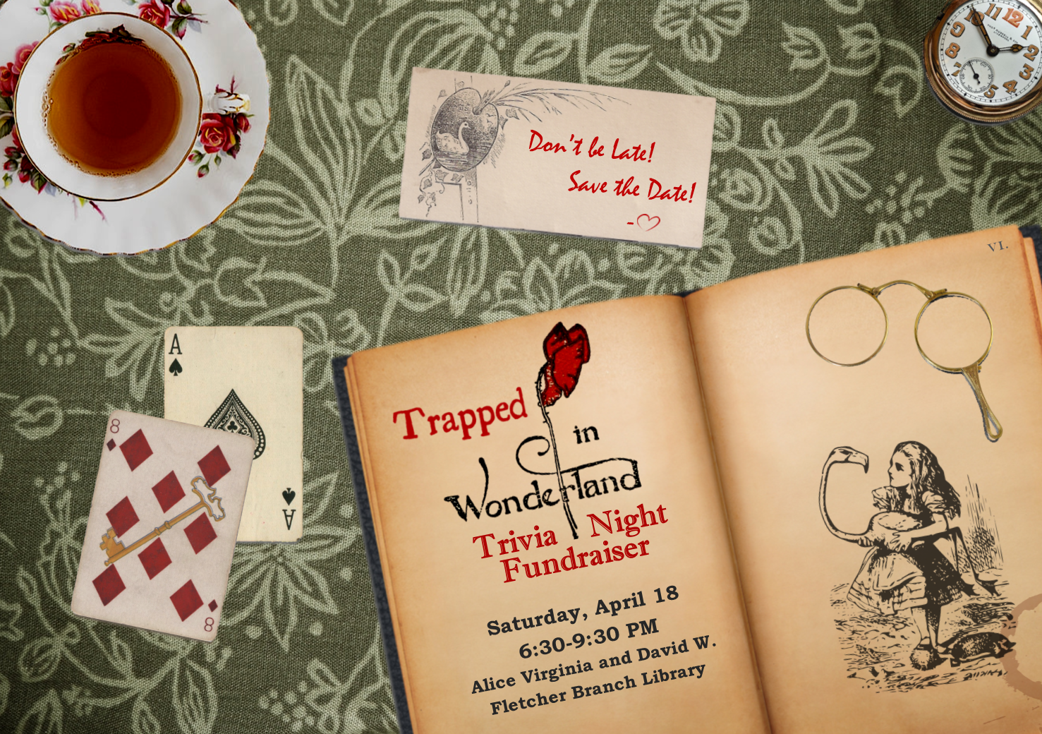 Image of tabletop with open books and other Alice in Wonderland-related items