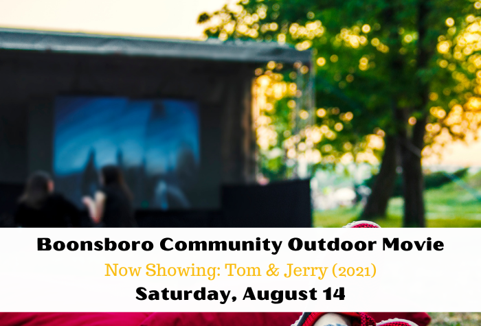 Blurred photo of outdoor movie screen and tree in the background and community movie information on white band across bottom