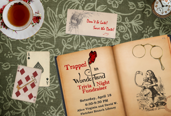 Image of tabletop with book, watch, playing cards, tea, and Alice in Wonderland themed artwork